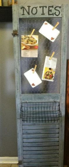 shutter repurposed with chicken wire insert to hold notes and attached wire basket by flora
