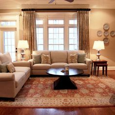 Here is a family room with an orange oriental rug like mine.