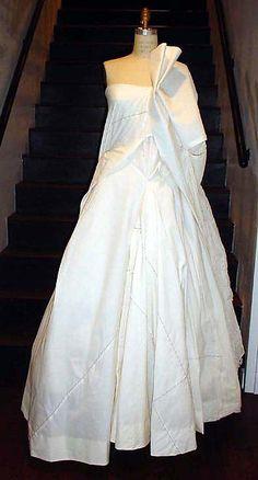 Wedding dress Designer: Yohji Yamamoto (Japanese, born Yokohama, 1943) Date: spring/summer 2000 Culture: Japanese Medium: a) cotton, nylon, silk; b) cotton, nylon Dimensions: Length at CF (a): 63 in. (160 cm) Length at CB (b): 41 1/4 in. (104.8 cm)Wedding dress