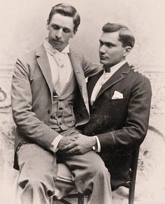 Oh goodness, this is so beautiful! With remarkable clarity for being in excess of a century old, this photograph perfectly captures the enduring affection between sitters - two impeccably dressed gentlemen, clasping hands tightly as they adopt such an intimate pose before the camera - the charming coynes of one averting his eyes as the other looks up at him with a hint of a smile - whether friends, relatives, or lovers, they truly loved one another, that is certain.