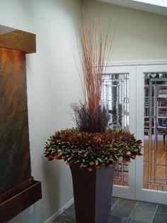 magnolia-leaf-and-twig-arrangement.jpg at a glance, brown