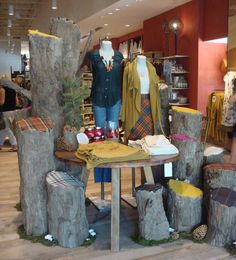 faux tree stumps as display pieces. Visual merchandising. Retail store display. Men's clothing.