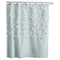 Charming shower curtain with handmade cascading floral accents.