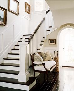 Wonderful foyer, great arched doorway, black floors.