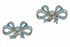 A PAIR OF EARLY 19TH CENTURY TURQUOISE AND DIAMOND SEVIGNÉS BROOCHES  The double loop ribbon set throughout with cushion shaped old-cut diamonds interspersed with turquoise cabochon accents, mounted in silver and gold, circa 1835, 8.7cm wide, later fitted case