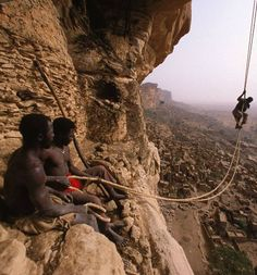 Using ropes made of bark, men traditionally scale the formidable Bandiagara cliffs in Mali, West Africa