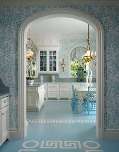 scott snyder glam kitchen--blue and white wallpaper, greek key floor detail, bamboo furniture, white cabinets