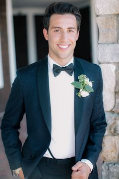 Handsome groom in a unique navy polka dot tux.