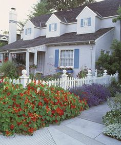 cottage garden with white picket fence