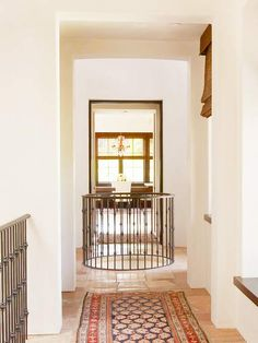 For enclosed foyers - cut a whole in the ceiling to the 2nd floor and add railing.  It becomes a skylight & opens up the foyer.