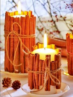 Tie cinnamon sticks around your candles. the heated cinnamon makes your house smell amazing. good holiday gift idea too. Tie cinnamon sticks around your candles. the heated cinnamon makes your house smell amazing. good holiday gift idea too. Noel Christmas, Winter Christmas, Christmas Candles, Christmas Centerpieces, Centerpiece Ideas, Candle Decorations, Winter Decorations, Fall Winter, Rustic Christmas