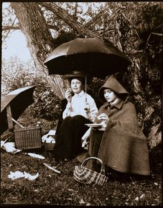 Fitting for a rainy New England day | Lunch under the umbrella | Photograph albums collection (PC009) -- Historic New England