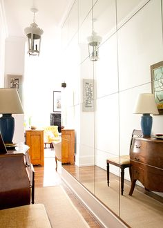Full Wall of Mirrors in Small Hallwayhttp://www.designsponge.com/2013/10/a-tiny-upper-east-side-gem.html