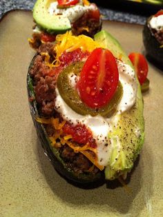 Avocado Taco Boats... I am SOO veganizing this!!!! refried beans or black beans? Topped with Wholly Guacamole!