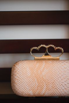 Blush snakeskin bridal clutch with heart details | Binaryflips Photography | www.theknot.com