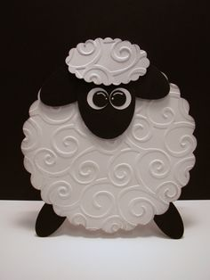 same wool texture but as a little black sheep. big eyelashes, big earrings, little pink bow. this tattoo WILL happen