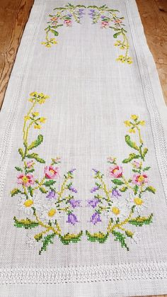Beautiful floral cross stitch embroidered tablerunner tablecloth in mint condition. Spotless. The size is: 38 x 14 1/2  The material is linen, cottonthread International shipping  Also offer combined shipping and refund if the shipping cost is overpaid.  Contact me if you have questions  Thank you