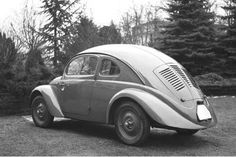 "1936 BEETLE  (PROTOTYPE) It included no rear window and ""suicide doors"" that opened from the front."