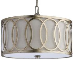 """$348   12"""" Dia A classic fixture, this pendant combines modern style and antique finishing. Interlocking oval rings, with slight imperfections, circle a round drum. Bulbs are concealed, casting soft ambient lighting. Distressing adds texture and warmth to the pendant and finial, silver leaf with hints of gold."""