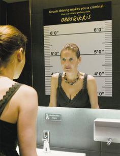 Police Mug Shot Mirror.  Rikkis, a door-to-door taxi company, used clever posters to promote their services. When viewed in the reflection of the mirror, they gave the consumer the impression that they were posing for a mug shot.