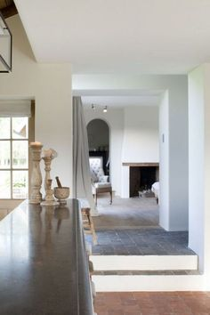 Stone floors, curved plaster fireplace