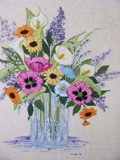 Poppies, lilacs, callas, daisies