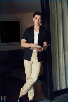 "Standing tall at 6' 0"", Miles Teller wears a Bottega Veneta shirt with a Calvin Klein tank, Bottega Veneta trousers, and Church's leather loafers."