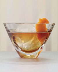Ice  2 ounces overproof bourbon  1/2 ounce Carpano Antica Formula or other sweet vermouth  1/4 ounce cherry Heering  1/4 ounce Bénédictine   1 orange twist, for garnish    Fill a chilled pint glass with ice. Add all of the remaining ingredients except the garnish and stir well. Strain into an ice-filled coupe, pinch the orange twist over the drink and drop it in.
