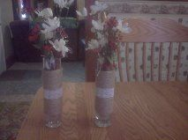 Twine wrapped vases with lace hot glued across center.  Use these as my dining room table décor.