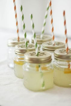 Mason Jar Sippers ~ Includes 12 8 oz. jars with daisy perforated metal lids and 12 sturdy multi-color paper straws.