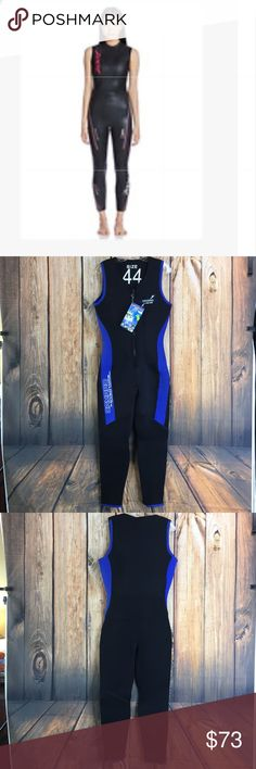 ⭐️💙Women's CAMARO sleeveless wetsuit size 44 ⭐️💙NWT Women's CAMARO sleeveless wetsuit size 44  Measurements are approximate See size chart for measurements   Up for sale is a NWT Camaro sleeveless zip front wetsuit in size 44 (XL). Note* model shot is for reference only and not actual item for sale Camaro Swim