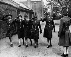In this May 5, 1944 file photo, five members of the Women's Army Corps serving with the Army Service of Supplies, salute an officer at a base in England. More than 150,000 American women served in the WAC during World War II, becoming the first women other than nurses to serve in the United States Army ~