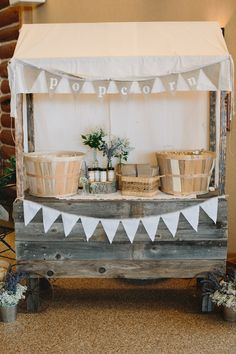 Popcorn table decoration with rustic vintage inspiration - wedding photo by Michigan-based wedding photographers Bryan and Mae