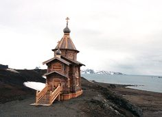 Trinity Church, first Russian Orthodox Church build on King George Island in Antarctica. Project by Siberian (Barnaul) architects P.Anisiforov, S.Ribak and A.Shmidt, construct in Altai by carpenter team of K.Khromov, demolish, ship by water to Antarctica, and reconstruct.