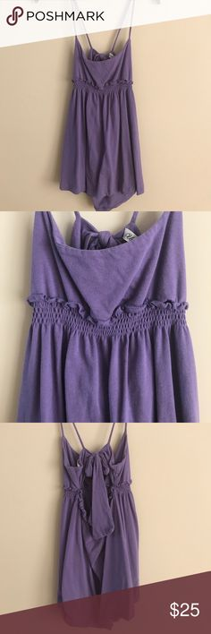 « NWOT Urban Outfitters Tank » New without tags urban outfitters tank. It has a cute bow in the back with a cutout. Never worn, size large. Urban Outfitters Tops Tank Tops