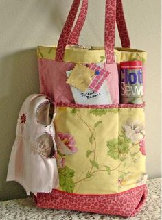 "#FreeSewingPattern - check out this adorable Shopper's Fancy Tote Pattern by Indie Designer Jo-Lydia's Attic! We love the deep side pockets and the adorable variety of colors and patterns on the fabric! Click the image to get your free instant download of the pattern and click ""Repin"" if you think this is the perfect bag to carry to and from your favorite fabric store! #sewing #pattern"