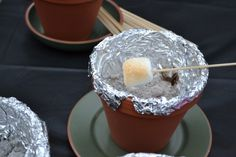 So cool. Put charcoal in terracotta pots and have tabletop smores.