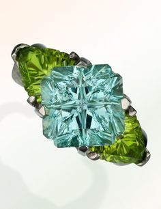 A platinum ring set with a 6.94-carat aquamarine and peridot of just over 5 carats by Tracy Janule