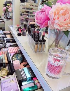 Organise makeup in plastic divided drawer organisers, and display lipstick collection in an acrylic organiser