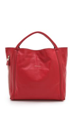 Pop on a pop of Poppy Red this season with this See by Chloe Harriet Hobo.