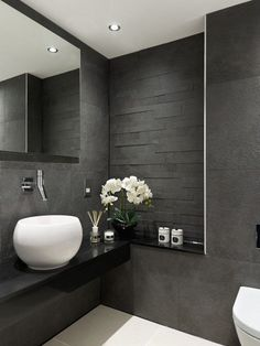 modern bathroom designs gray tiles black vanity white sink wall mirror