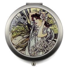 Compact mirror with Four Seasons design for touch-ups on the go. A lovely companion that easily fits in any purse. Made of metal.
