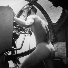 """This is the full frame of the famous picture nicknamed """"Rescue at Rabaul,"""" photographed by Horace Bristol (1944). It depicts a U.S. Navy PBY Catalina blister gunner who stripped off his clothes and dove into the ocean to rescue a downed airman under fire from the Japanese. As soon as he returned to the plane, the still-naked sailor got back to his position at his gun."""