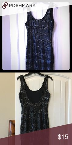 Black sequin dress with deep scoop neck and back. Black sequin dress with deep scoop neck and back. TCEC Dresses