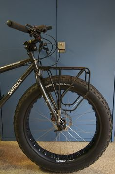 I am looking for ideas on what works for the Surly, Moonlander. Please post up photographs/descriptions on both front and rear racks. Thanks, Justin