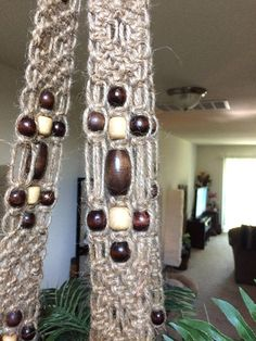 Large, Long Heavy Duty Macrame Plant Hanger of Natural Jute and Wooden Beads. Hanger is 36 inches from top of ring to bottom of pot seat and tail is 22 inches long. Hanger holds pot sizes 4, 6, 8, 12 and 16. Hanger easily holds up to 50 lbs.. Indoor or outdoor. Pictured with 6 inch