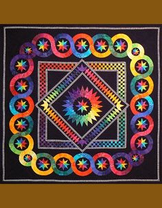 Rainbow Stars Quilt, byJacqueline DeJonge  BeColourful  She is Dutch quilt designed and her patterns are available in the states.