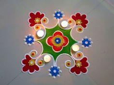Super Easy and Creative Diya Rangoli Designs.Diwali Special Rangoli Designs by Shital Mahajan. Rangoli Photos, Rangoli Simple, Simple Rangoli Designs Images, Rangoli Designs Latest, Rangoli Designs Flower, Rangoli Border Designs, Small Rangoli Design, Rangoli Patterns, Colorful Rangoli Designs