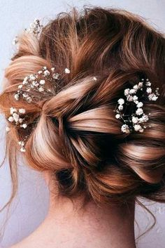 Charming Bridesmaids Hairstyles Completed With Flowers ★ See more: http://lovehairstyles.com/bridesmaids-hairstyles-flowers/