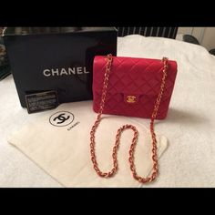 """AUTHENTIC   CHANEL  BAG Beautiful Red  Chanel  bag. (Never carried). Quilted, Lambskin leather. gold tone hardware, flap with logo turn lock. Leather-laced and chain 45"""" shoulder strap. Leather lining with one zipper pocket and two flip pockets. Comes with authenticity card, dust cloth and box. Made in Italy. Purchased from Saks Fifth Ave.  Excellant condition!! CHANEL Bags"""